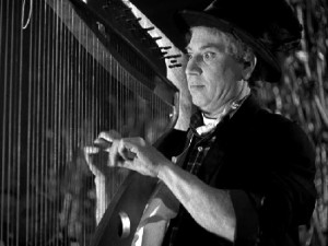 Harpo turns an annihilated piano into a harp, then plays a tune for us