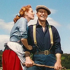 Maureen O'Hara whispers a funny line into the Duke's ear to get a reaction, one that she's kept secret all these years