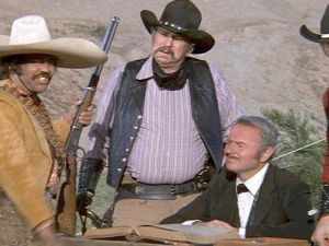 The Bandit needs no stinkin' badges. Along with Slim Pickins and Harvey Korman, we see villainry in western parody.