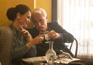 CHEERS to Julia Ormond as Marie Calvet and John Slattery as Roger Sterling - 7th Season, Episode 14 - Photo Credit: Michael Yarish/AMC