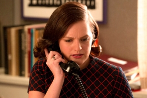Elisabeth Moss as Peggy Olson gets an intense call from Don - 7th Season, Episode 14 - Photo Credit: Michael Yarish/AMC