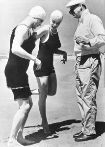 Jack Lemmon and Marilyn Monroe get direction from Billy Wilder- in matching swimsuits