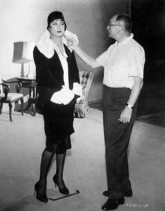 Tony Curtis in Josephine wardrobe, as Wilder checks details