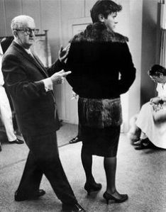 Wardrobe also played a key role in convincing cross-dressing. Here famous designer Orry-Kelly checks details and fit.