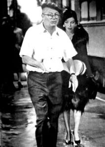 Billy giving direction to Marilyn for the 'train station runway' scene.
