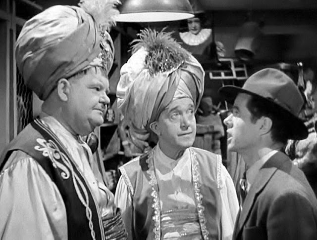 Stan-Laurel-Oliver-Hardy-and-Elisha-Cook-Jr.-in-A-Haunting-We-Will-Go-1942